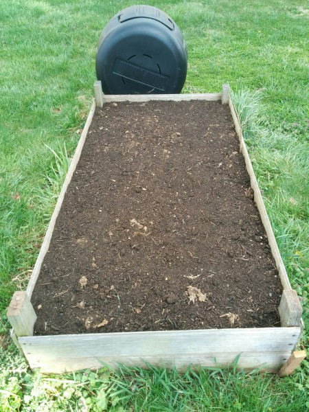 raised bed with radishes and spinach